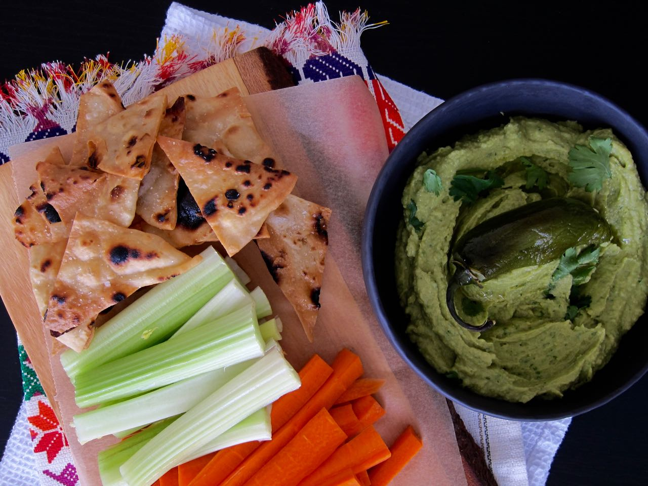 spicy avocado hummus with dippers