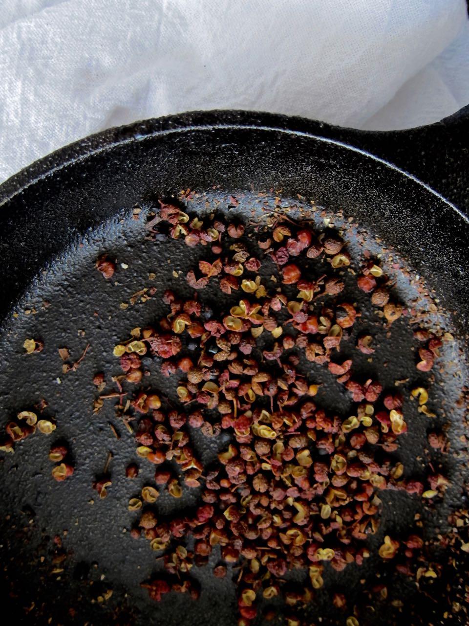 toasting sichuan peppercorns.jpg