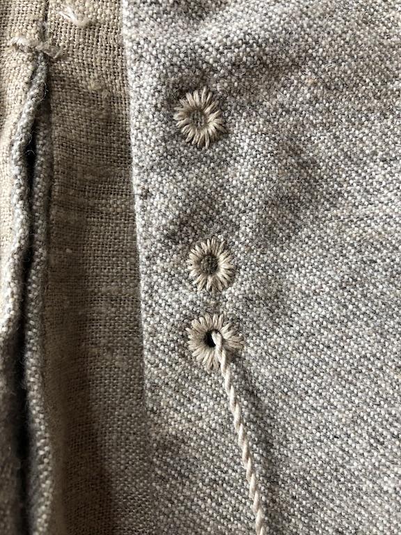 Mary's jacket eyelet detail.jpg