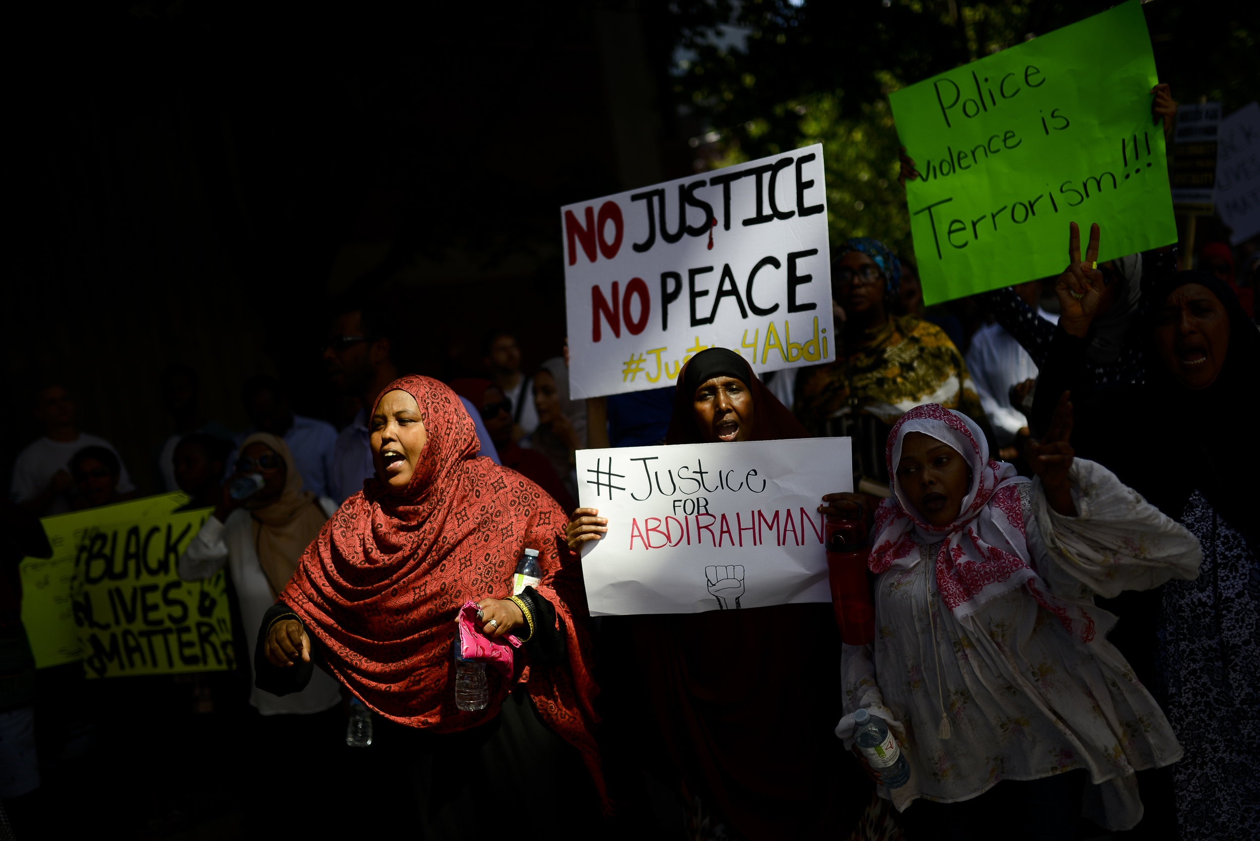Demonstrators march from Somerset Square park to Ottawa Police headquarter on Elgin street during the March for Justice - In Memory of Abdirahman Abdi.