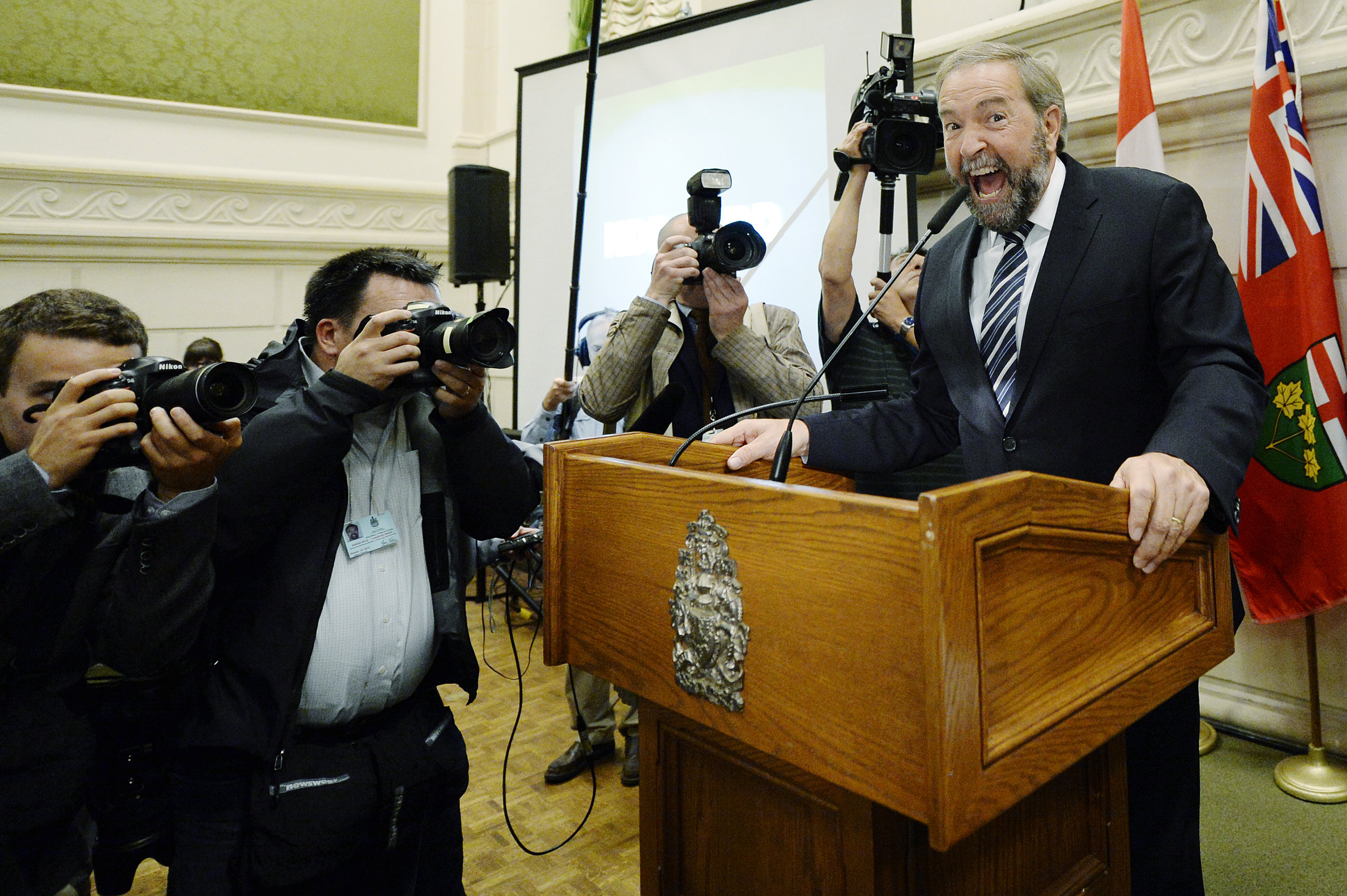 The leader of New Democratic Party of Canada Tom Mulcair cheers on the party members during NDP Caucus meeting. NDP has opened their doors to the media when they boycotted Conservative Party's caucus meeting.