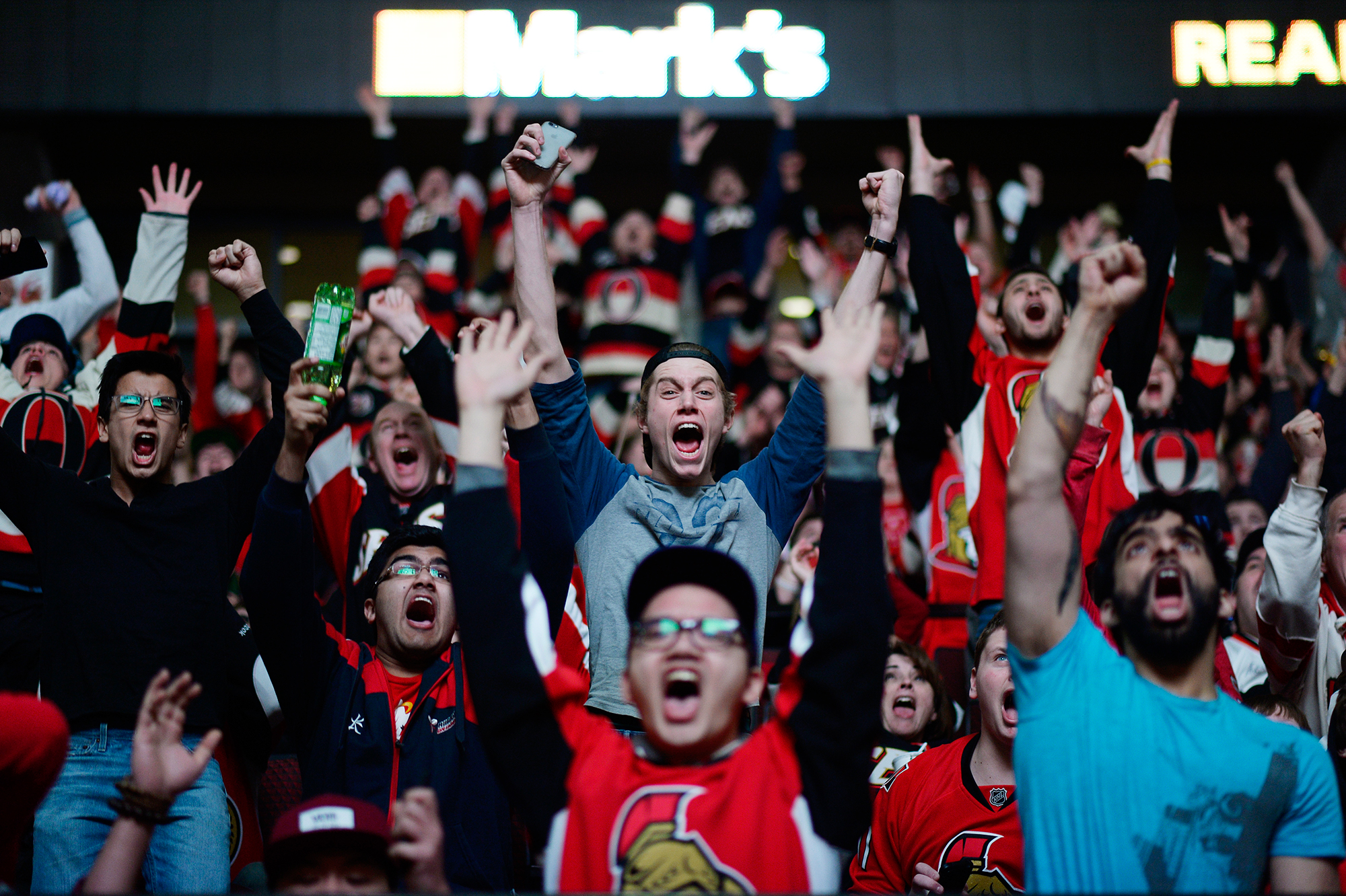 Ottawa Senators fans cheers as the team score the second goal against Philadelphia Flyers and clinch the playoff spot. Fans watched the game on the big screen at Canadian Tire Centre on Saturday, April 11, 2015.