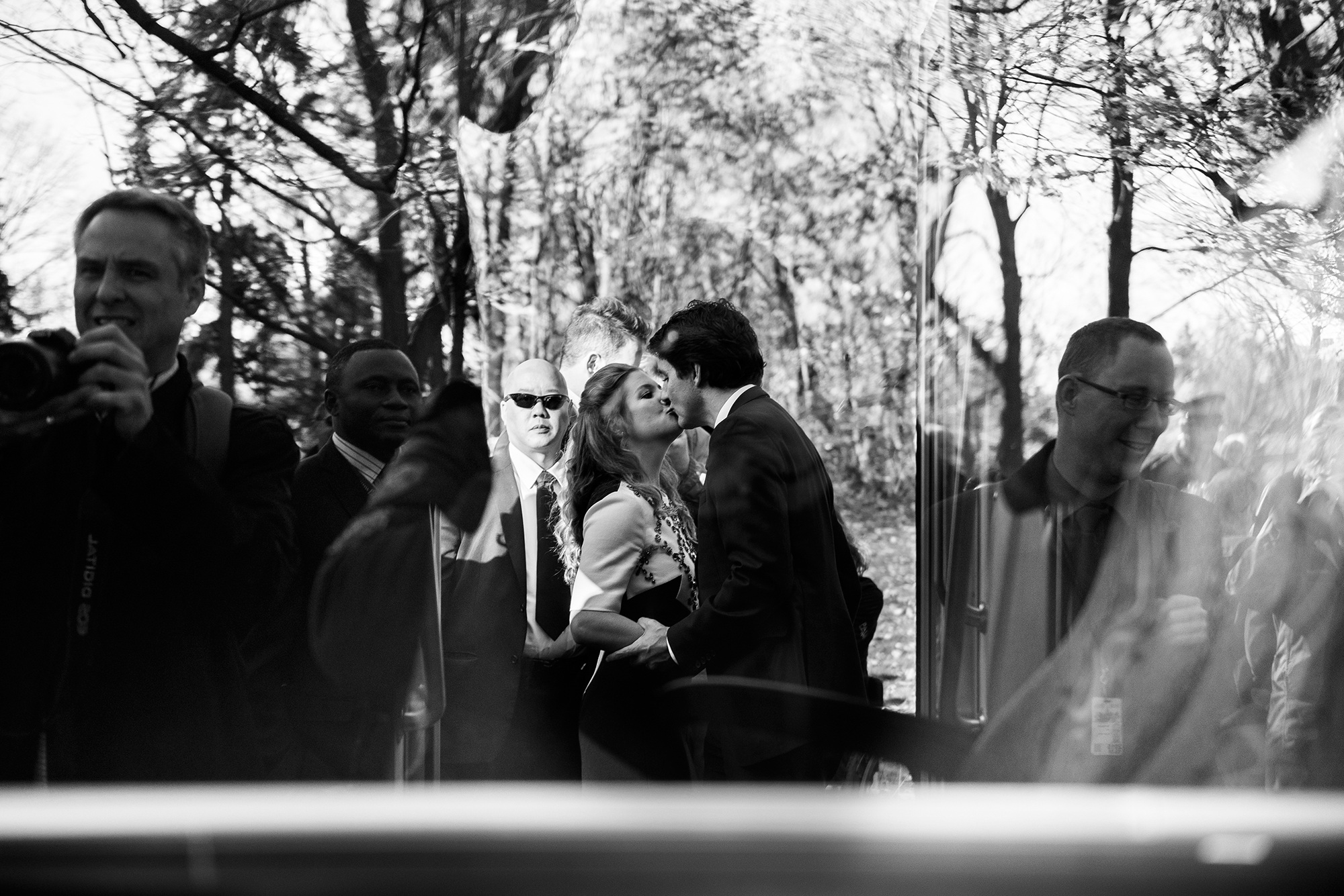 Newly elected Prime Minister Justin Trudeau shares a kiss with his wife Sophie Grégoire Trudeau before hopping on the bus after Swearing-In ceremony held at Rideau Hall.