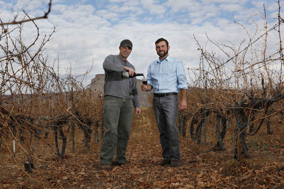 Garrett Portra, left, new owner of Carlson Vineyards in Palisade, and Joe Neuhof, executive director of Colorado Canyons Association, recently partnered to serve Portra's new red wine blend, River's Edge, as a fundraiser for the nonprofit association, which cares for three Grand Valley national conservation areas.