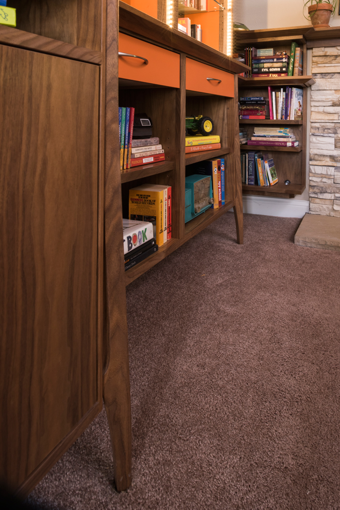 Design + Build of custom Walnut Mid-Century Inspired entertainment center.