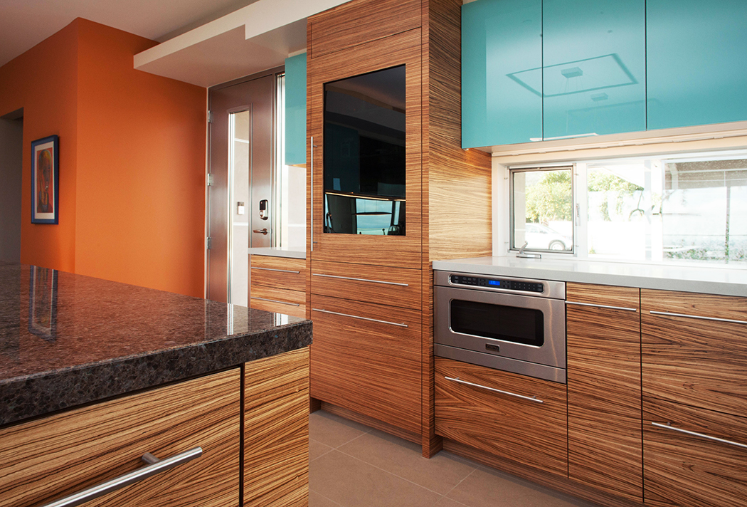 Modern Zebrawood Cabinets with Blue Glass