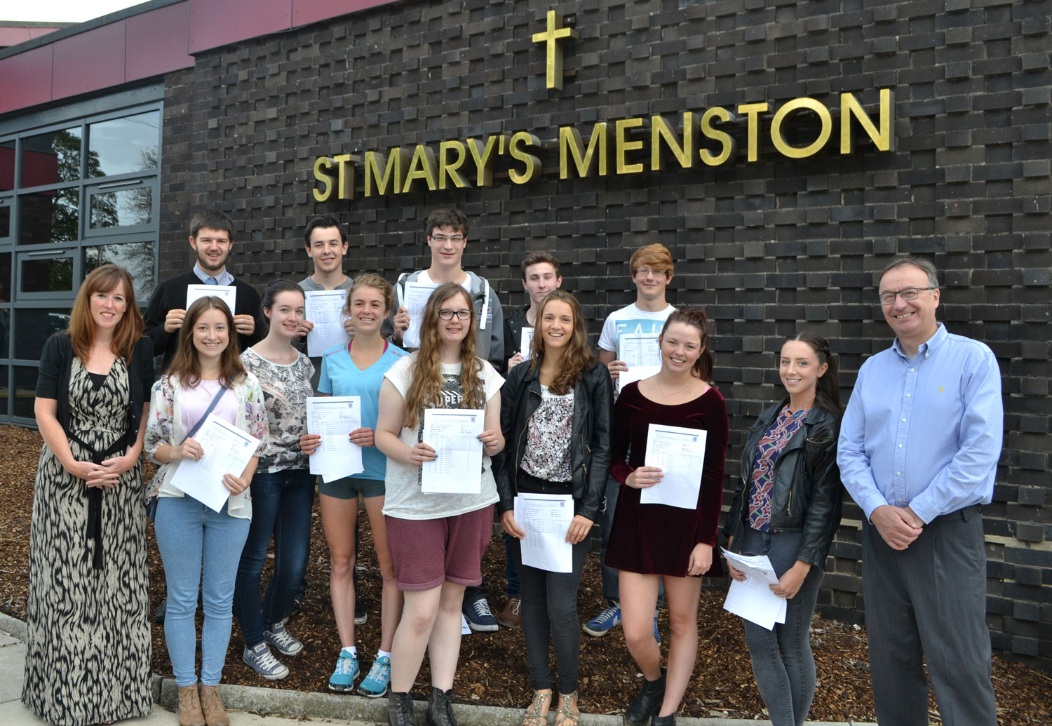 Photo: Acting Headteachers Miss C Garrett And Mr T Rothwell join Year 13 pupils for a commemorative photo, A-Level Results Day, Thursday 14 August 2014