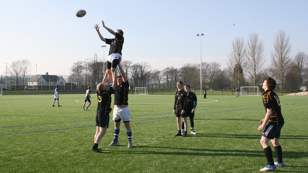 Rugby being played on the pitch