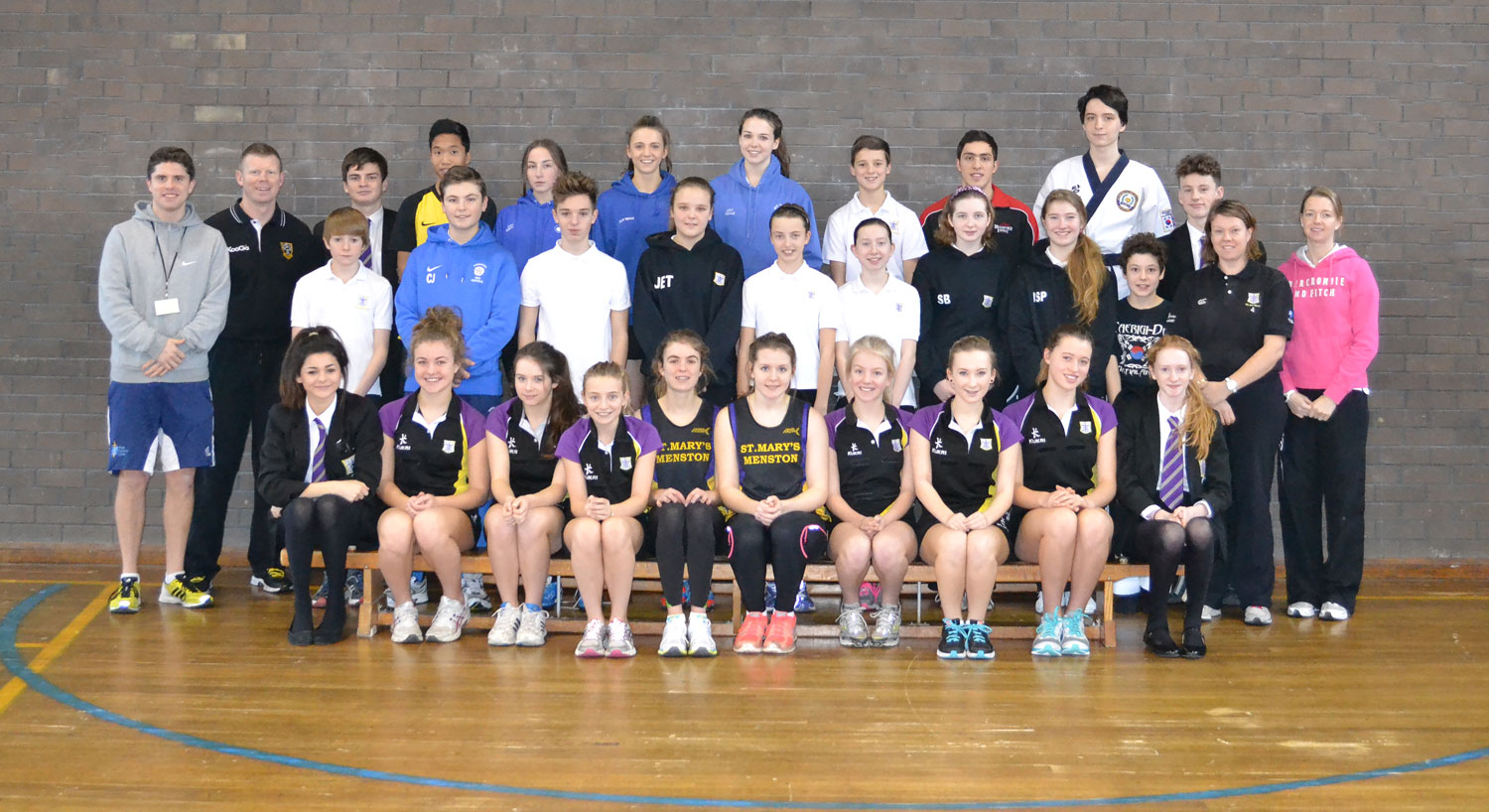 Proud moment: PE and Sport staff join pupils who have been featured on our website for their recent sporting achievements for a commemorative photo in our Gymnasium, January 2014