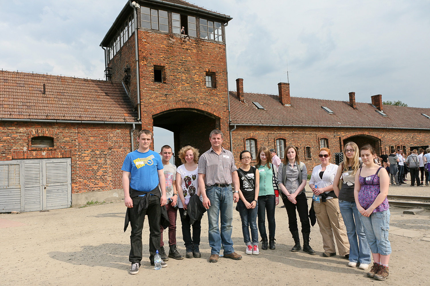 Photo: Pudsey MP Stuart Andrew, Mrs Burrows with students at Auschwitz-Birkenau in Poland