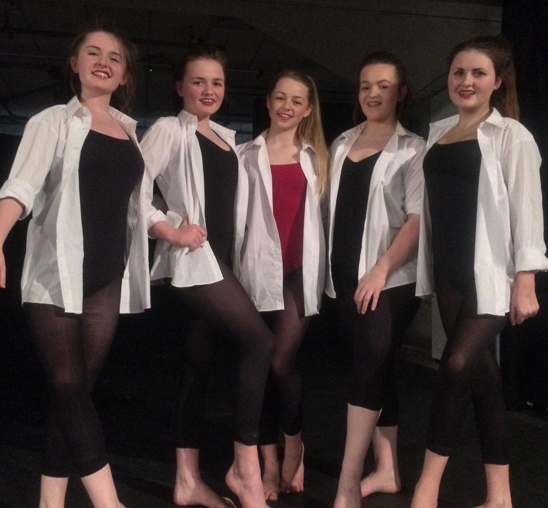 Photo: Key Stage 4 Leeds Dance Champions Left To Right: Chloe Williams, Devon Mitchell Mccann, Alicia Wilson (Choreographer), Gabriella Vento and Freya-Poppy Bowden