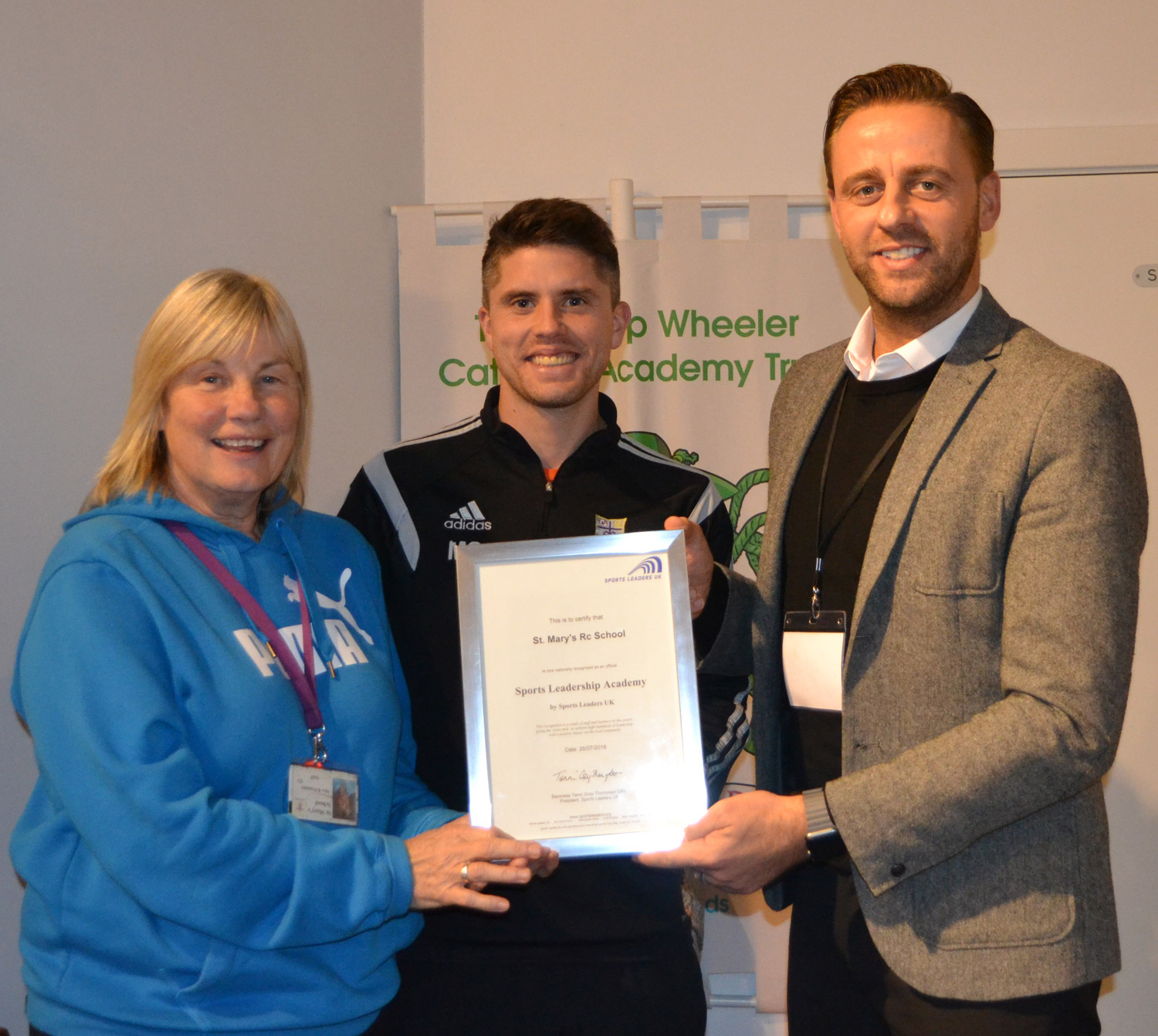 Photo:Mr David Savage from Sports Leaders UK presented the award to St. Mary's PE Teachers Mrs Pounder and Mr Pringle on behalf of the Faculty of PE and Sport.