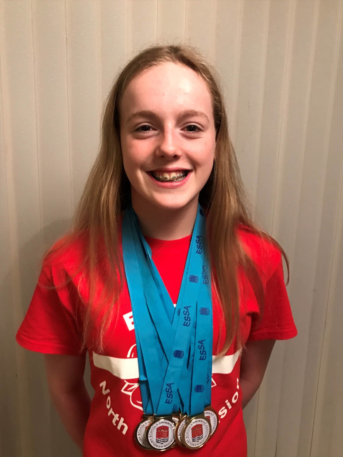 Photo: Izzy and her English Schools gold medals