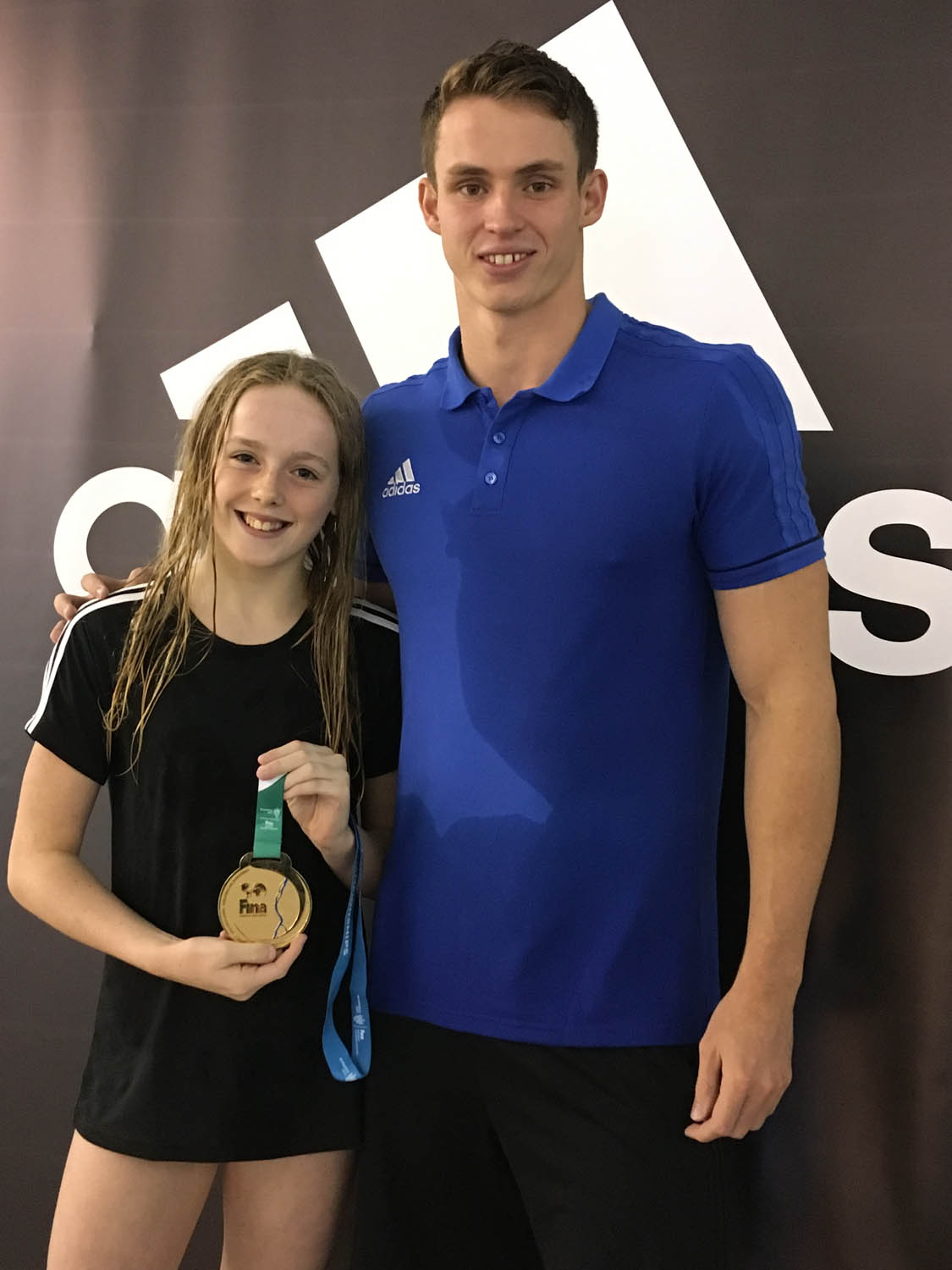 Photo: Izzy with Ben Proud (current commonwealth and world champion in the 50m freestyle event)