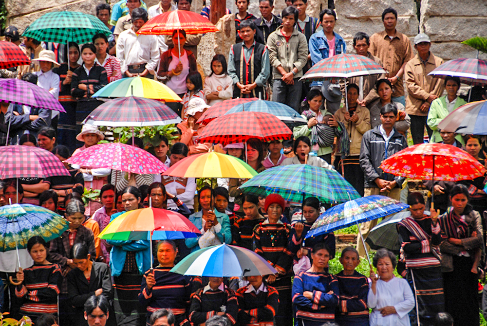 Montagnard people in Vietnam's Central Highlands attend a Catholic memorial mass for a deceased priest.