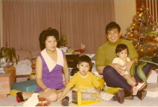 Jo as a toddler with her parents and older brother.