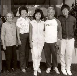 1987—Jo with her maternal grandmother, parents, and brother.