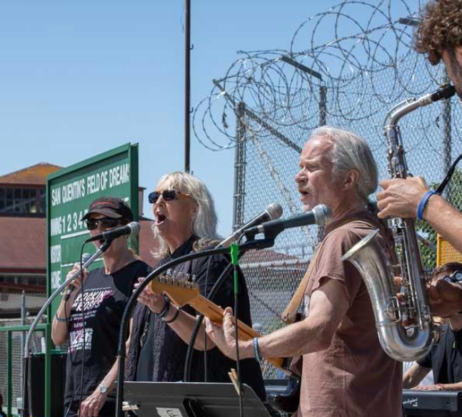Day of Peace performance by members of Bread and Roses. Guitarist Kurt Huget teaches guitar playing at San Quentin.