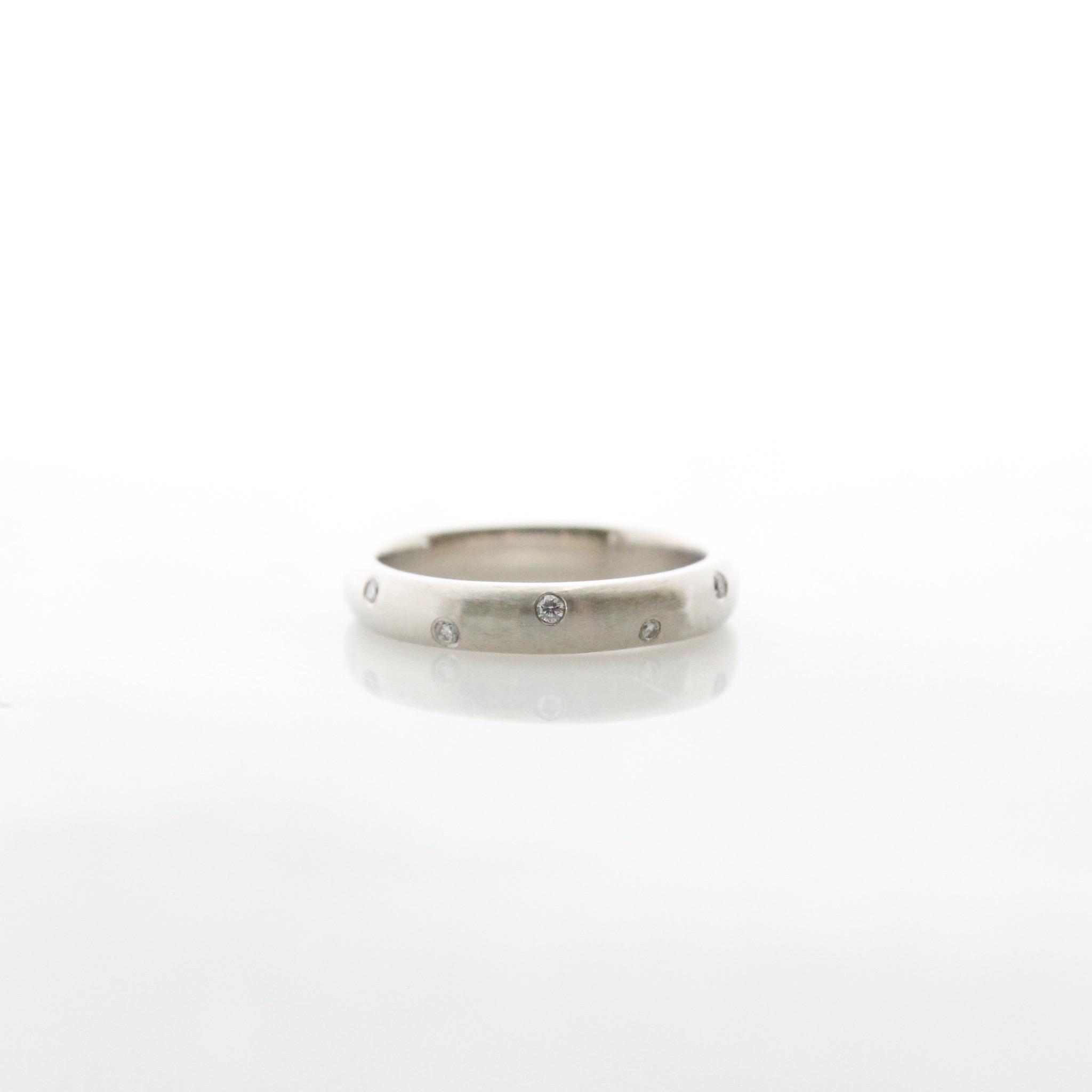 18k white gold band with gypsy set white diamonds