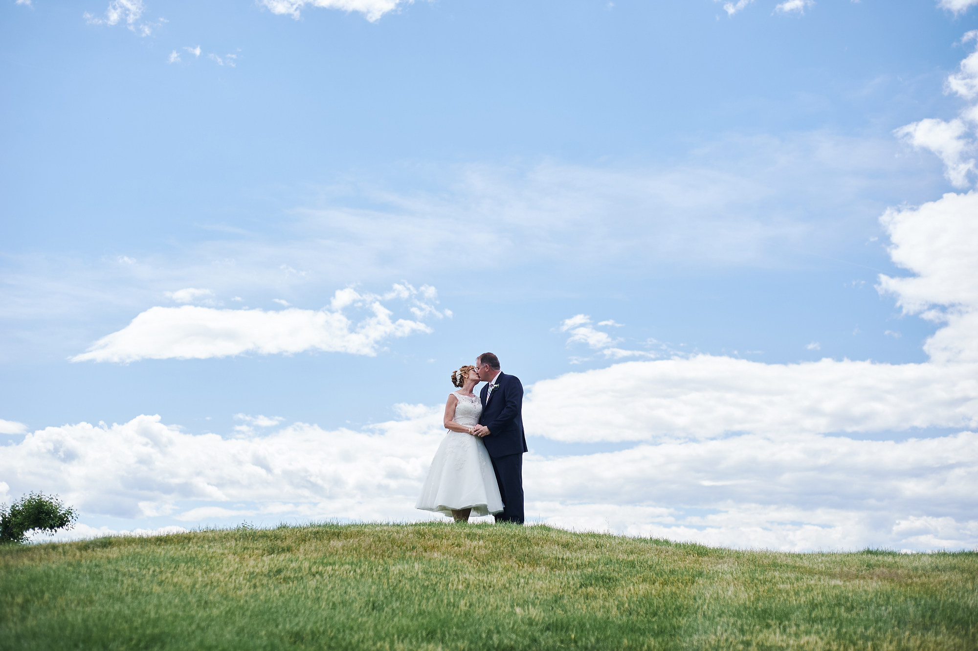 wedding portrait against blue sky