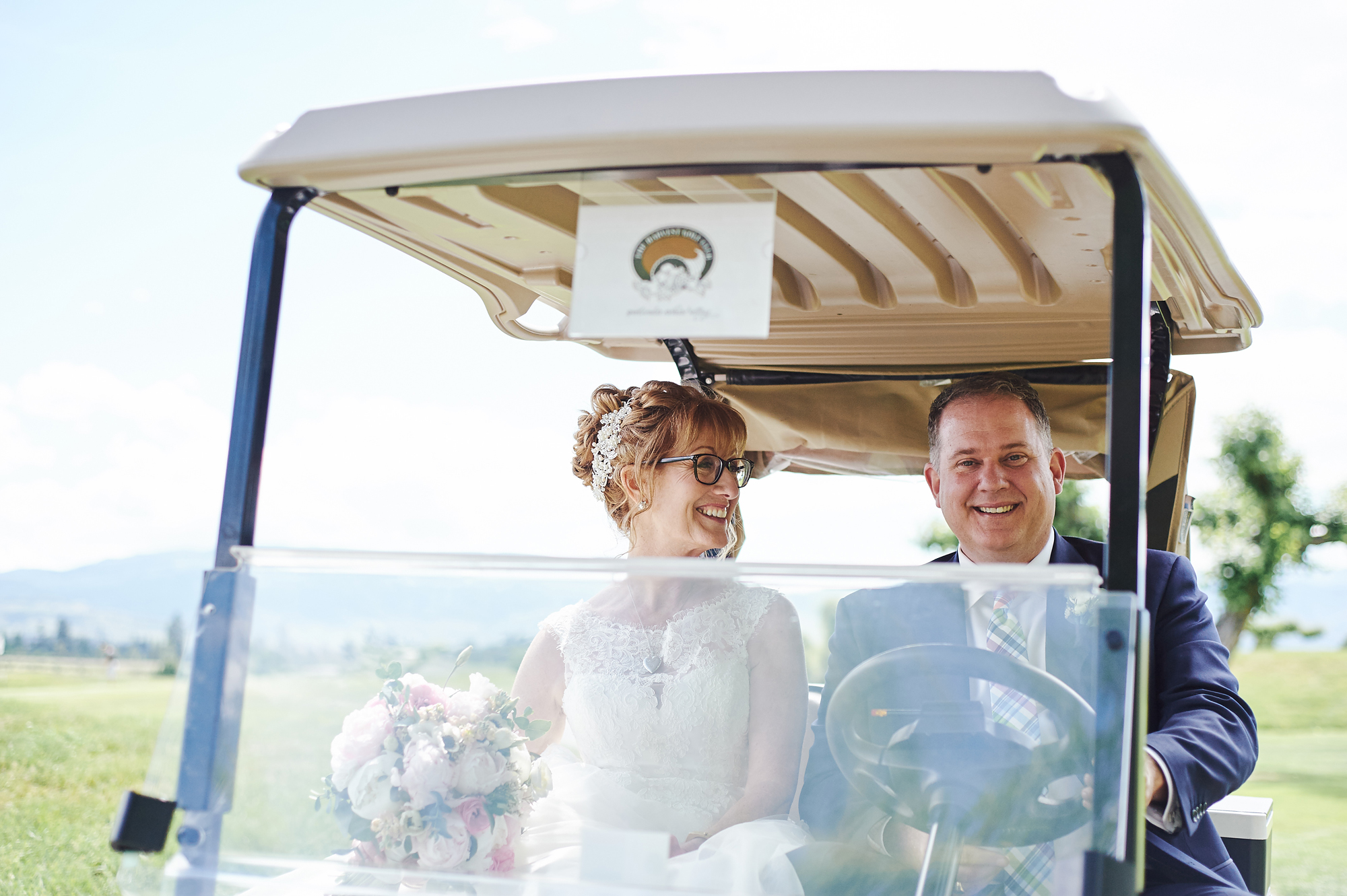 Married couple in their golf cart