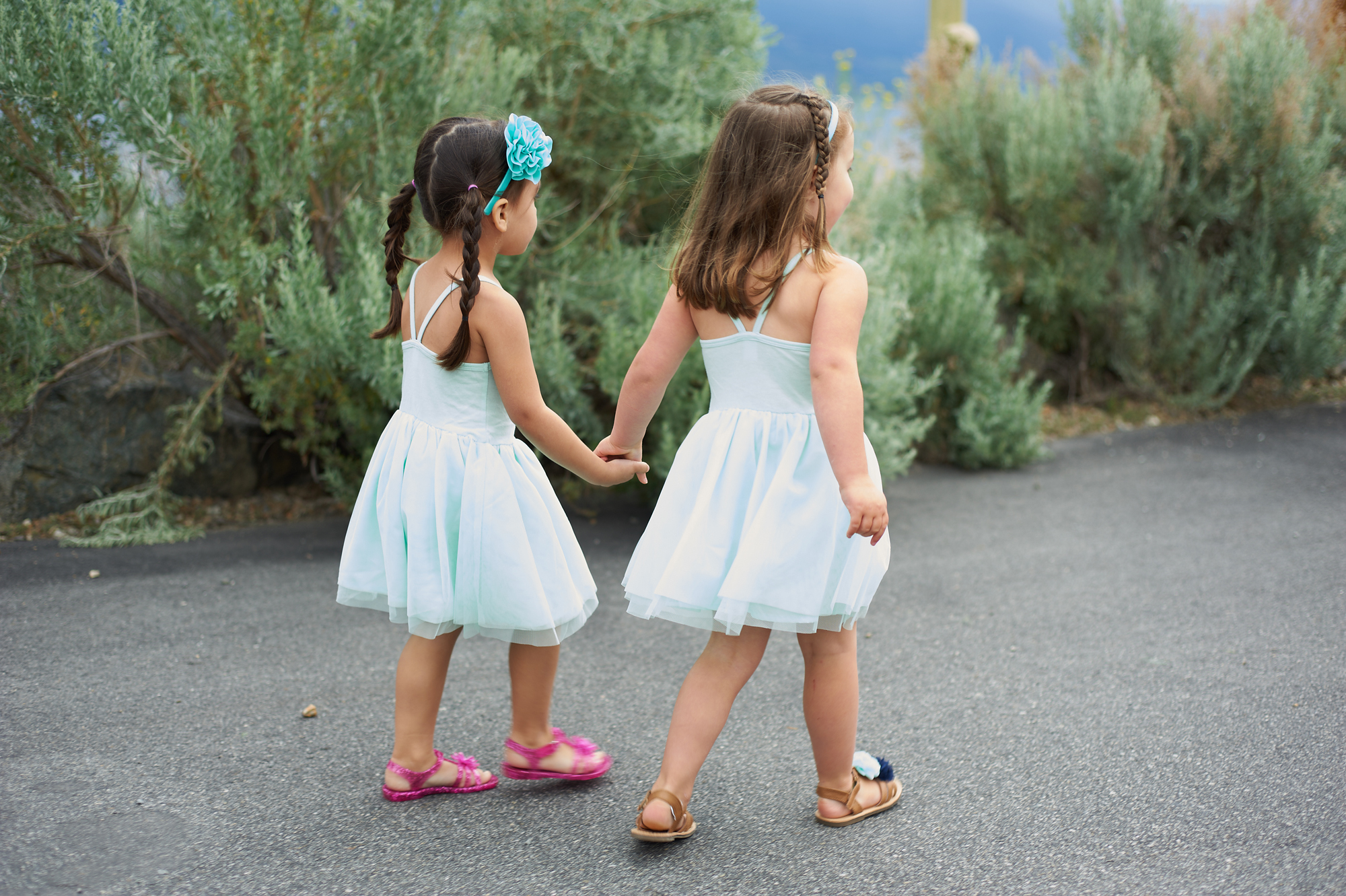 two flower girls walking