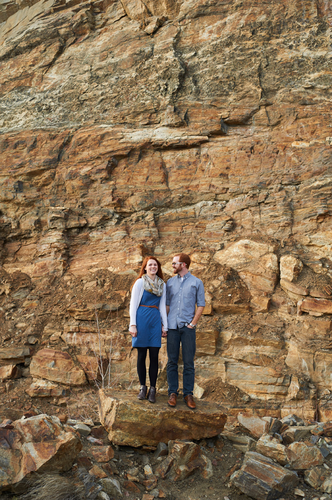 engaged-couple-in-front-of-colored-rock-wall-at-myra-canyon.jpg