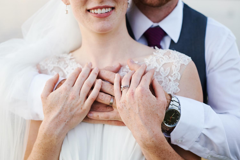 bride-and-groom-formal-portrait-with-wedding-rings.jpg