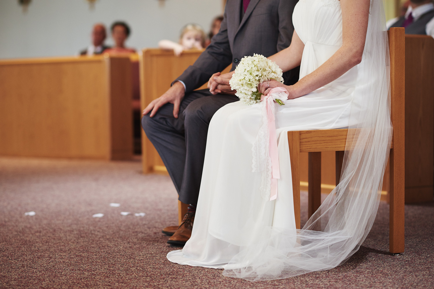bride-and-groom-holding-hands-during-the-wedding-ceremony.jpg