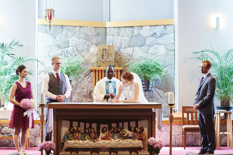bride-signing-the-register-in-a-roman-catholic-church.jpg