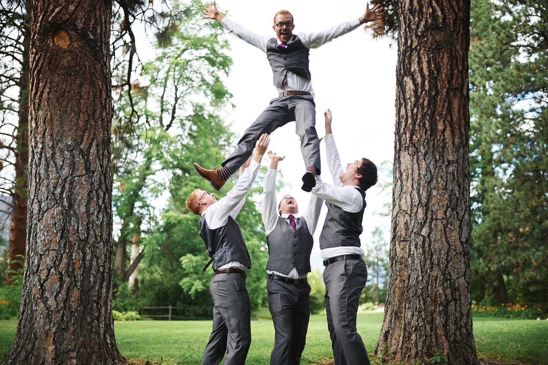 fun-groomsmen-photo-tossing-the-groom-into-the-air.jpg
