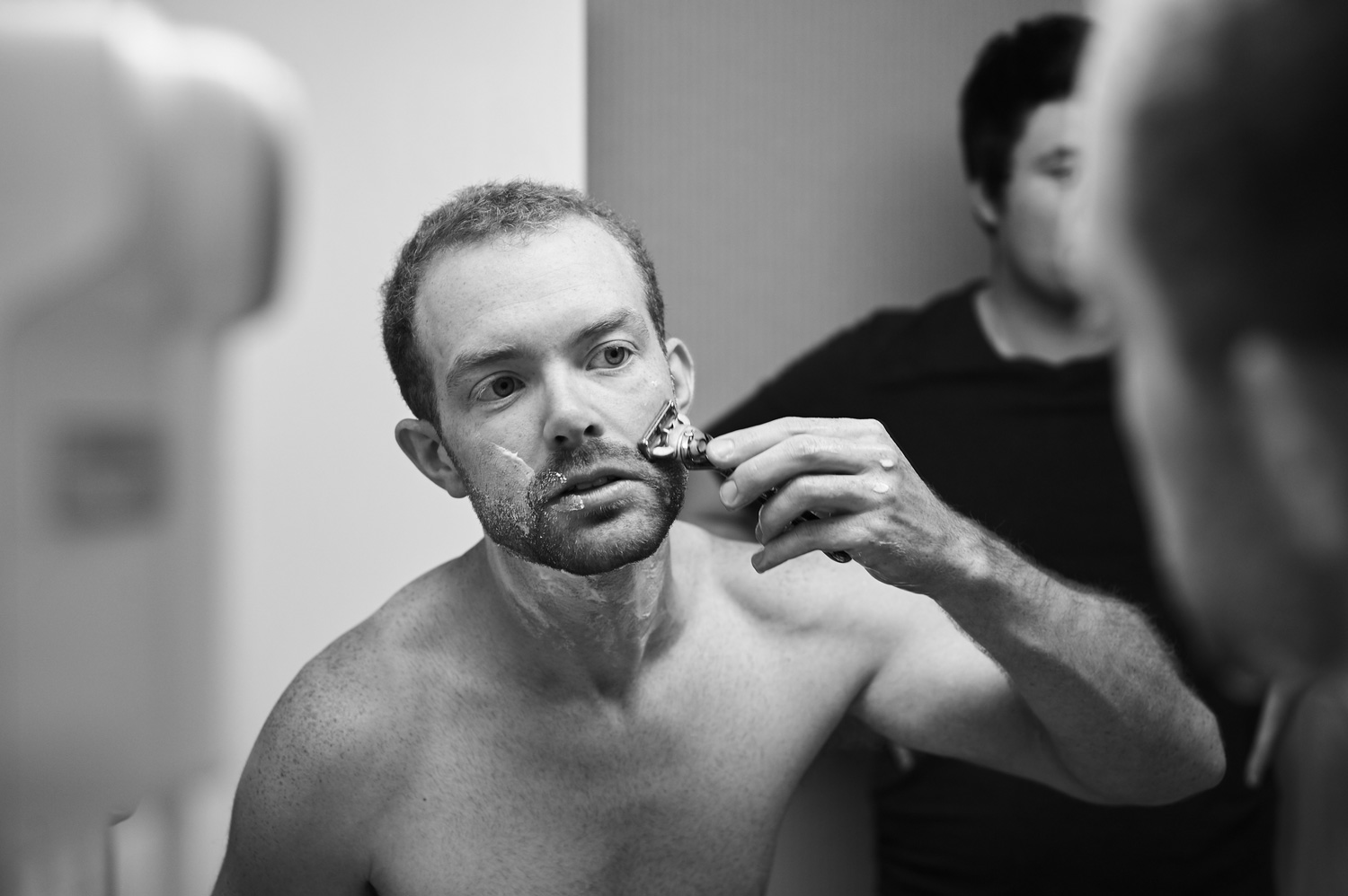 groom-shaving-and-getting-ready-black-and-white.jpg