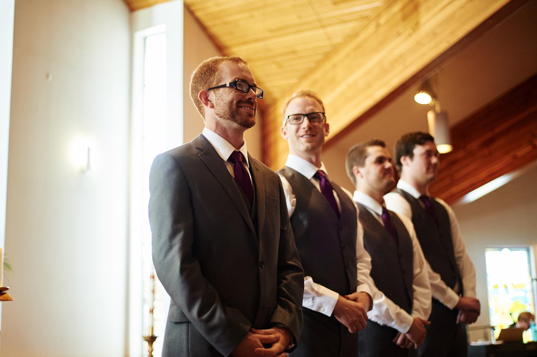 the-groom-sees-his-bride-walkign-down-the-aisle.jpg