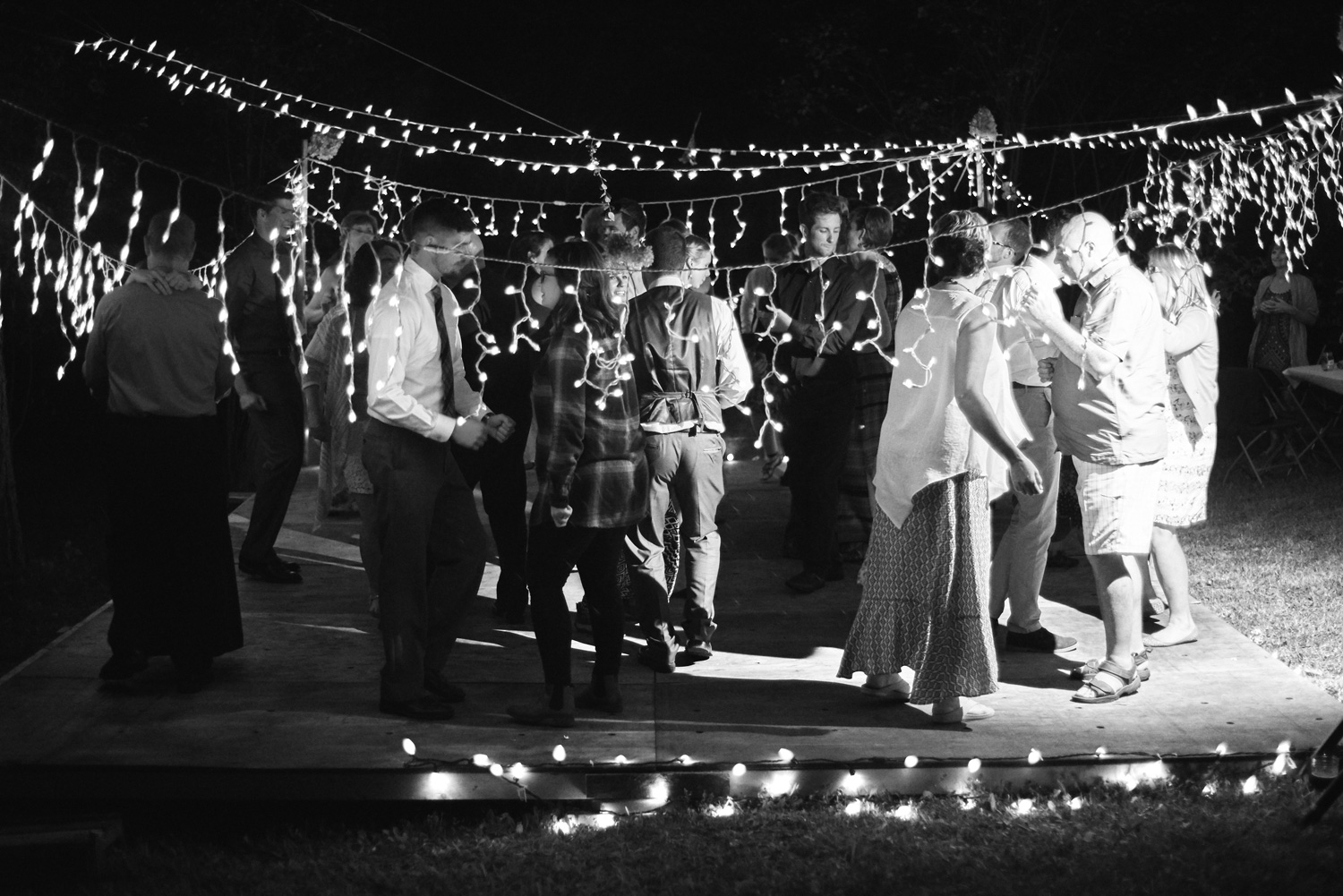 black-and-white-photo-of-a-dance-at-outdoor-reception.jpg