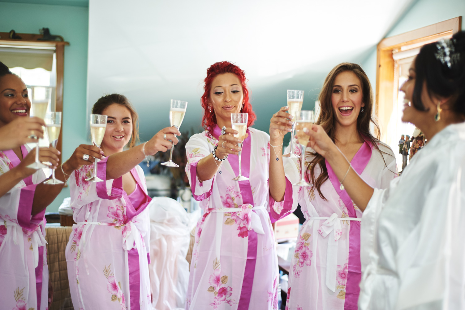 bridal-party-sharing-a-glass-of-champagne-together.jpg