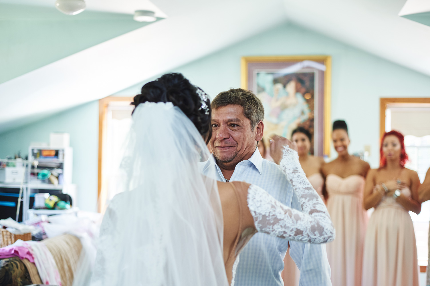 father-of-the-bride-crying-over-seeing-his-daughter-in-her-wedding-dress.jpg