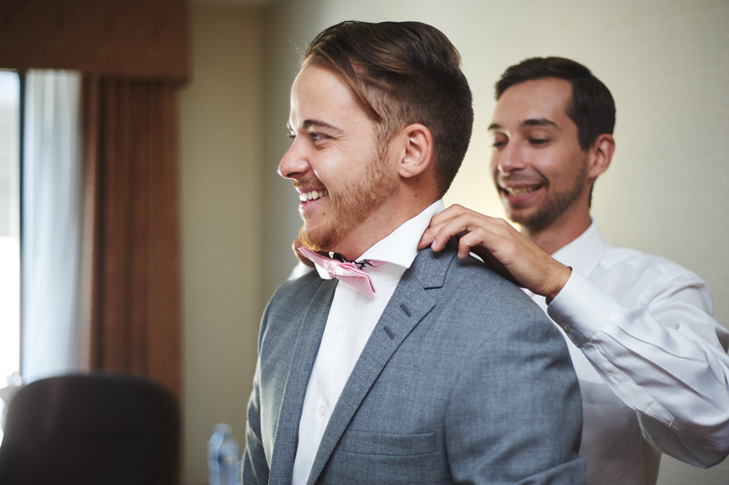 groom-having-his-collar-adjusted-by-a-groomsman.jpg