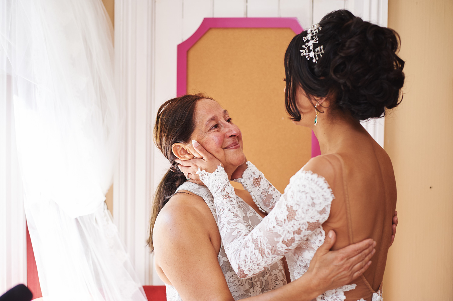 Mother-of-the-bride-helping-her-daughter-on-her-wedding-day.jpg