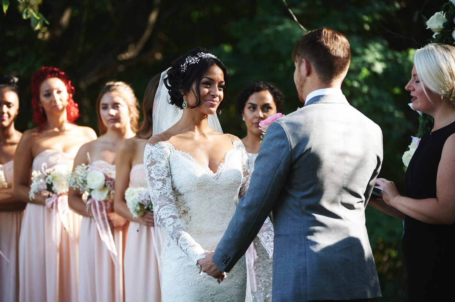 bride-and-groom-reading-their-vows-to-eachother-in-an-outdoor-ceremony.jpg