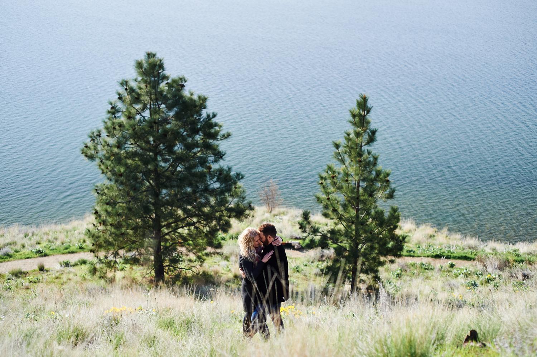 engaged-couple-by-okanagan-lake-by-kelowna-wedding-photographer.jpg