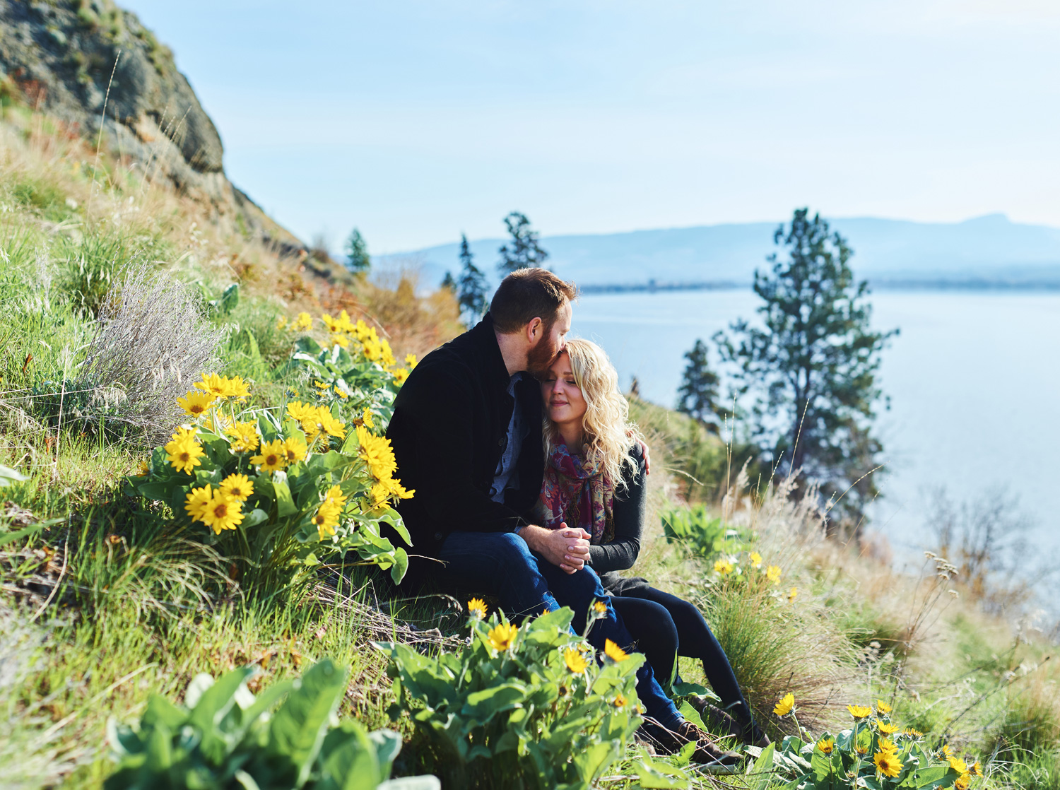 engaged-couple-with-arrowroot-flowers-in-the-okanagan.jpg