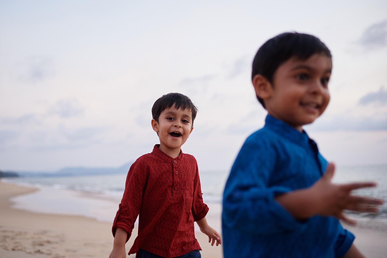 boy-running-by-the-ocean-thailand-destination.jpg