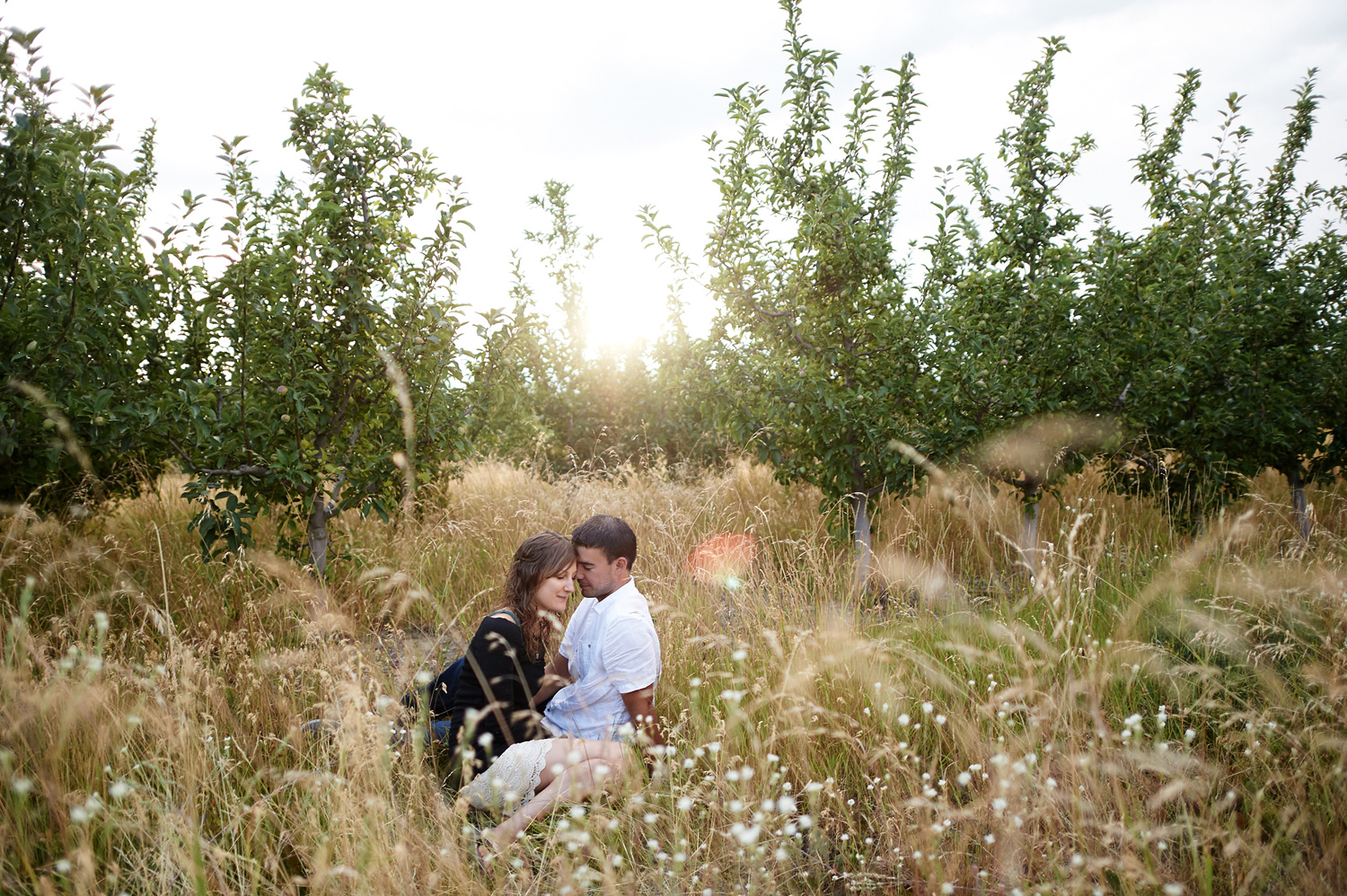 engaged-couple-snuggling-at-golden-hour-in-kamloops.jpg