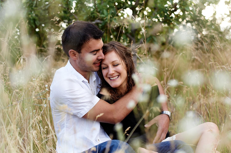 engaged-couple-snuggling-okanagan-.jpg