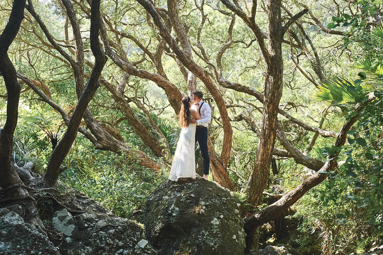 wedding portrait amongst trees on honeymoon