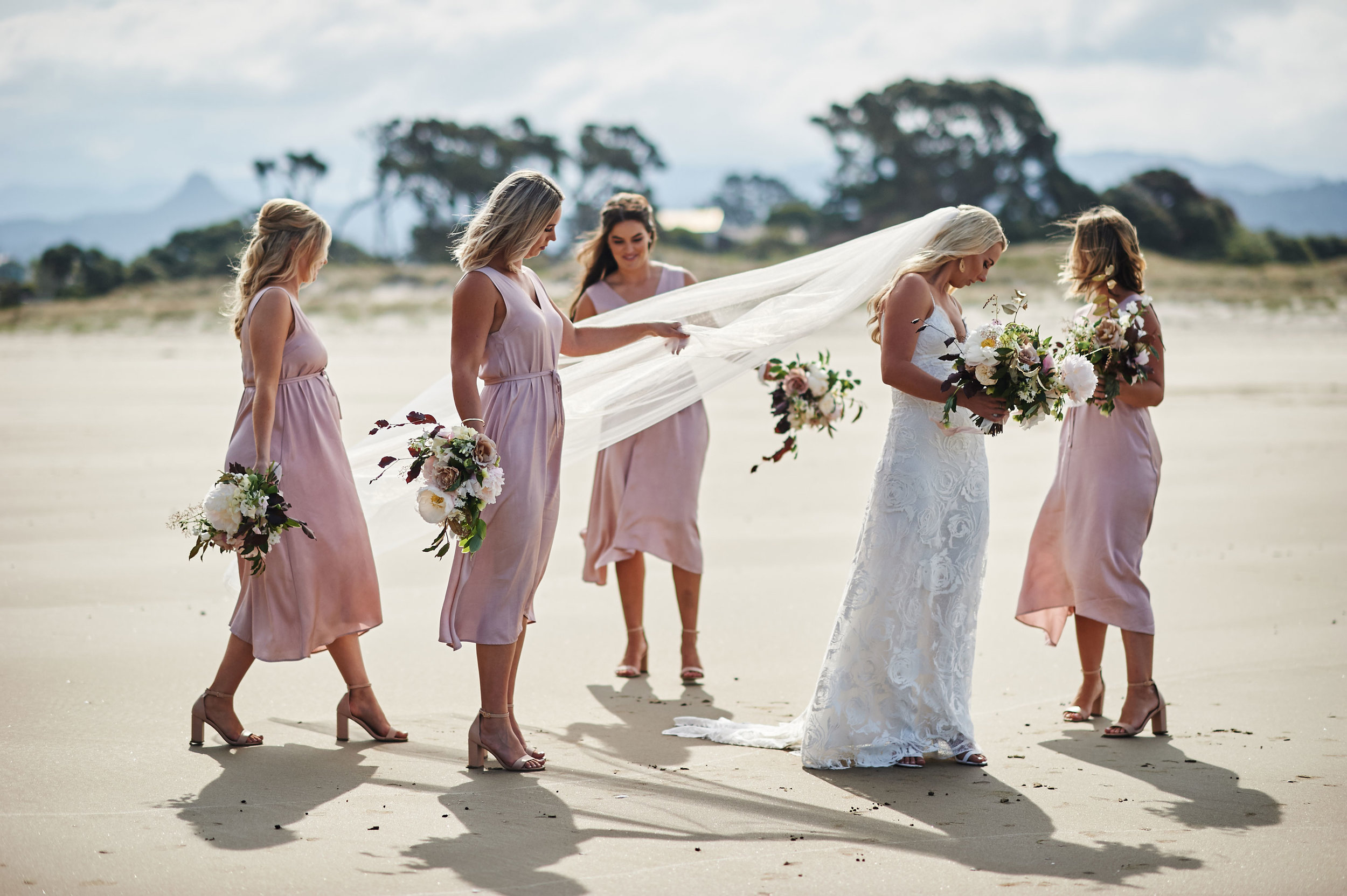 bride-and-her-bridesmaids-on-her-wedding-day.jpg