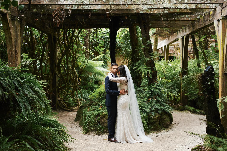 bride-and-groom-in-indoor-garden-on-wedding-day.jpg