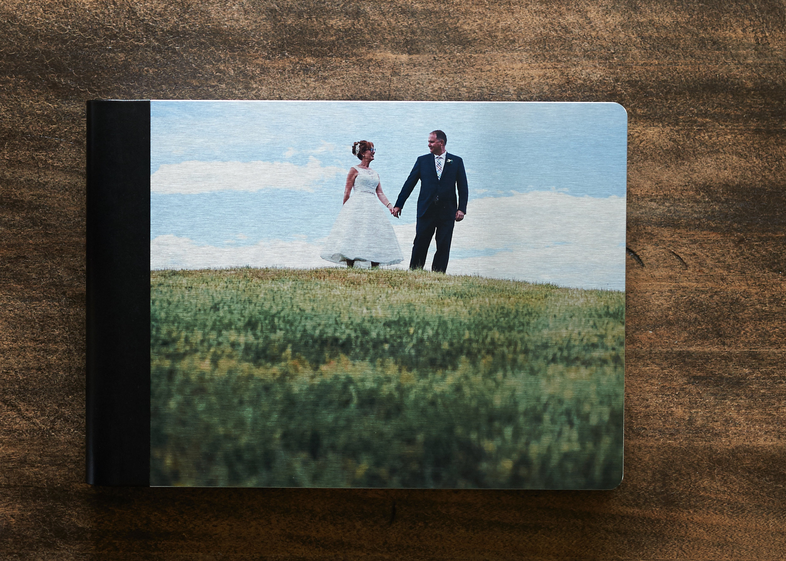 Wedding Albums - Professionally designed Italian made beauties, with archival papers, and a wide range of covers including our absolute favorite: A brushed metal color cover, and eco-leather binding. Wedding Albums start at $1100, with Parent Books available on request.