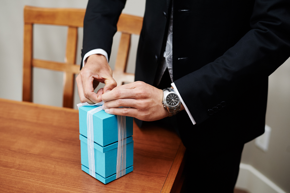 groom opening ring boxes