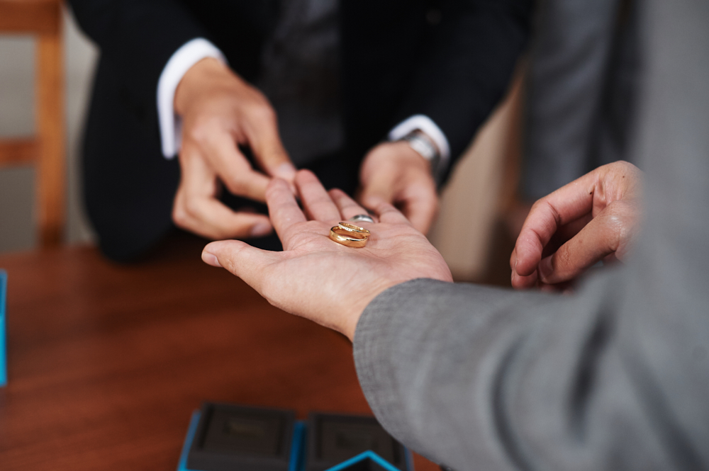 groomsmen holding wedding rings
